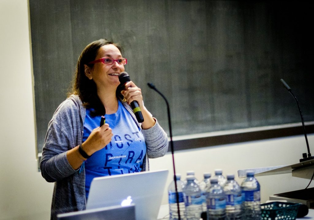 Francesca speaking at a conference